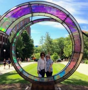 "Members at the ""Arriving Home"" sculpture, U-M campus"